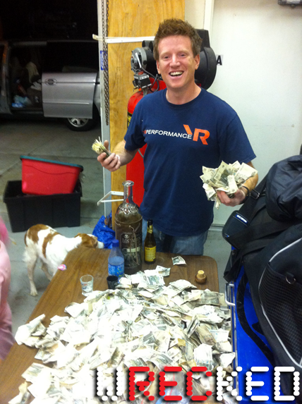 Bill Caswell and a table full of money